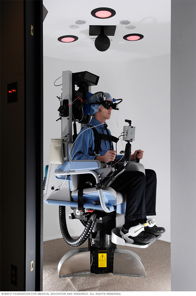 A person undergoing rotary chair test