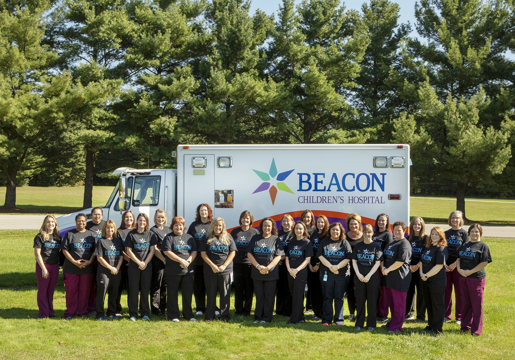 Beacon Health System Maternal-Fetal transport team standing outside of the ambulance.