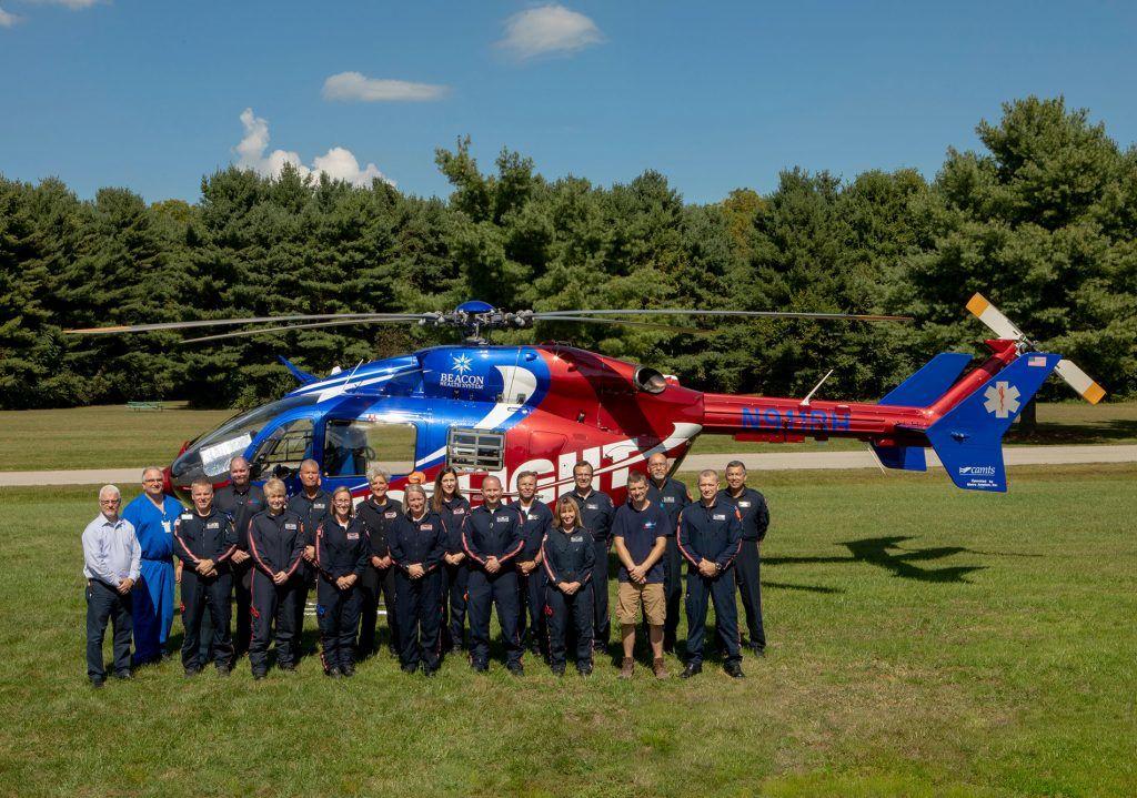 Memorial Mediflight team posing alongside the Medflight helicopter