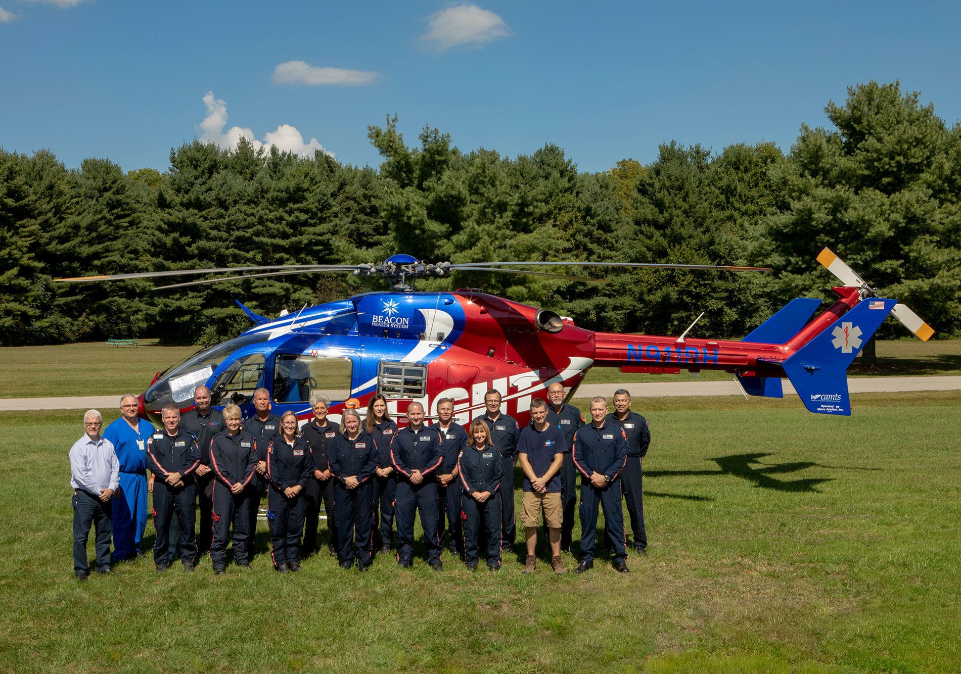 Memorial Mediflight team posing alongside the Medflight helicopter
